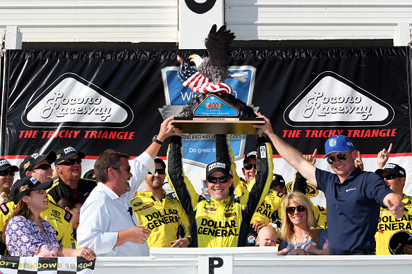 Matt Kenseth celebrates after winning the NASCAR Sprint Cup Series Windows 10 400 at Pocono Raceway on August 2, 2015 in Long Pond, Pennsylvania.