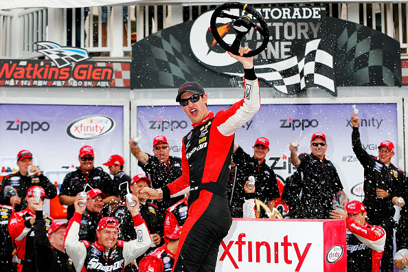 WATKINS GLEN, NY - AUGUST 08:  Joey Logano, driver of the #12 Snap-on Ford, celebrates in victory lane after winning the NASCAR XFINITY Series Zippo 200 at Watkins Glen International on August 8, 2015 in Watkins Glen, New York.  (Photo by Jonathan Ferrey/Getty Images)