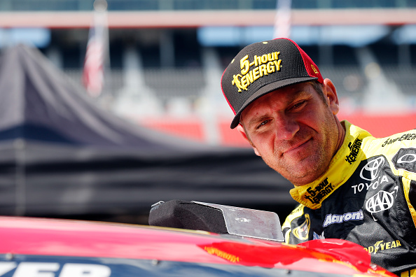 BRISTOL, TN - AUGUST 21:  Clint Bowyer, driver of the #15 5-hour Energy Toyota, climbs into his car during practice for the NASCAR Sprint Cup Series Irwin Tools Night Race at Bristol Motor Speedway on August 21, 2015 in Bristol, Tennessee.  (Photo by Brian Lawdermilk/Getty Images)