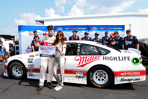DARLINGTON, SC - SEPTEMBER 05:  Brad Keselowski, driver of the #2 Miller Lite Ford, poses with the Coors Light Pole Award and Miss Coors Light Amanda Mertz after qualifying for the pole for the NASCAR Sprint Cup Series Bojangles' Southern 500 at Darlington Raceway on September 5, 2015 in Darlington, South Carolina.  (Photo by Matt Sullivan/Getty Images)