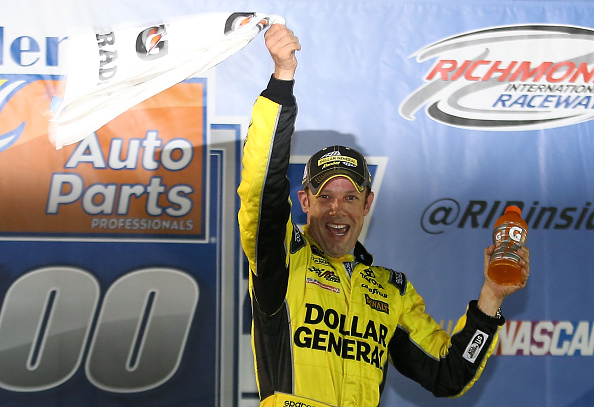 Matt Kenseth celebrates after the NASCAR Sprint Cup Series Federated Auto Parts 400 at Richmond International Raceway on September 12, 2015 in Richmond, Virginia.