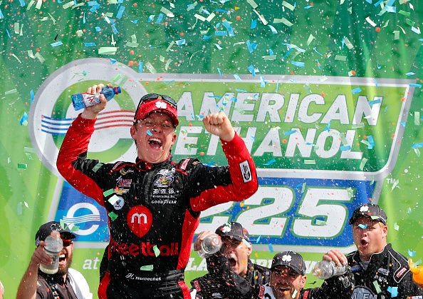 JOLIET, IL - SEPTEMBER 19:  John Hunter Nemechek, driver of the #8 Chevrolet, crosses the finish-line to win the NASCAR Camping World Truck Series American Ethanol E15 225 at Chicagoland Speedway on September 19, 2015 in Joliet, Illinois.  (Photo by Jonathan Ferrey/Getty Images)