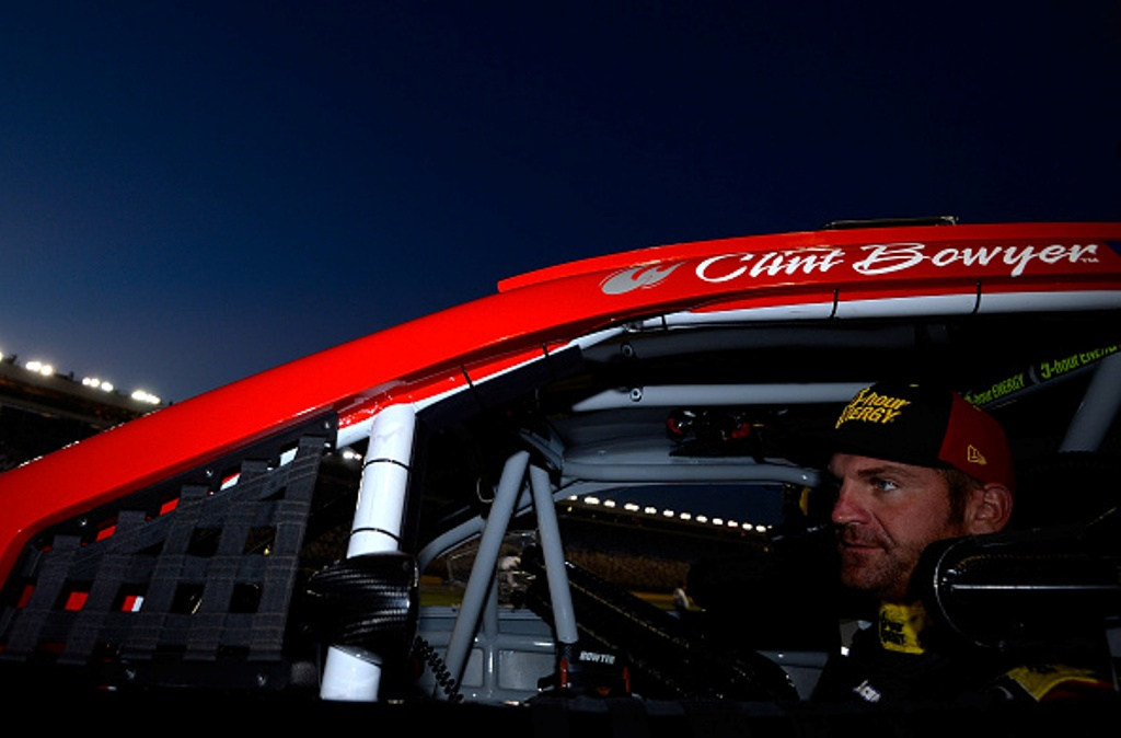 491883500-clint-bowyer-driver-of-the-5-hour-energy-toyota-sits-in