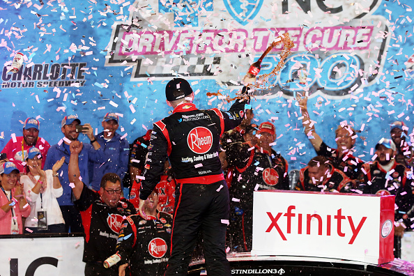 CHARLOTTE, NC - OCTOBER 09: Austin Dillon, driver of the #33 Rheem Chevrolet, celebrates in Victory Lane after winning the NASCAR XFINITY Series Drive for the Cure 300 at Charlotte Motor Speedway on October 9, 2015 in Charlotte, North Carolina. (Photo by Sean Gardner/Getty Images)