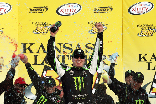 KANSAS CITY, KS - OCTOBER 17:  Kyle Busch, driver of the #54 Monster Energy Toyota, celebrates in Victory Lane after winning the NASCAR XFINITY Series Kansas Lottery 300 at Kansas Speedway on October 17, 2015 in Kansas City, Kansas.  (Photo by Todd Warshaw/Getty Images)