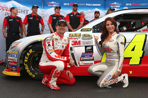 Jeff Gordon, driver of the #24 3M Chevrolet, poses with Miss Coors Light Amanda Mertz and the Coors Light Pole award after qualifying for the pole position for the NASCAR Sprint Cup Series CampingWorld.com 500 at Talladega Superspeedway on October 24, 2015 in Talladega, Alabama. (Photo by Sarah Crabill/Getty Images)