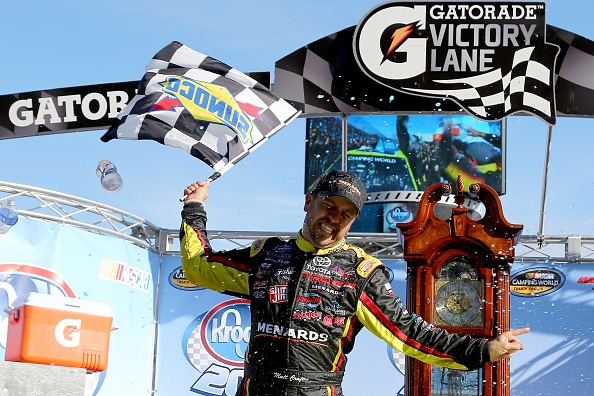 MARTINSVILLE, VA - OCTOBER 31:  Matt Crafton, driver of the #88 Fisher Nuts/Menards Toyota, celebrates in victory lane after winning the NASCAR Camping World Truck Series Kroger 200 at Martinsville Speedway on October 31, 2015 in Martinsville, Virginia.  (Photo by Sarah Crabill/Getty Images)
