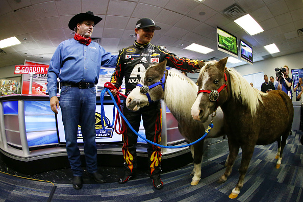 FORT WORTH, TX - NOVEMBER 06:  Texas Motor Speedway President Eddie Gossage (L) presents retiring driver Jeff Gordon with Shetland ponies for his kids during a press conference at Texas Motor Speedway on November 6, 2015 in Fort Worth, Texas.  (Photo by Tom Pennington/Getty Images)