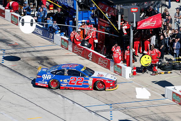 FORT WORTH, TX - NOVEMBER 08:  Joey Logano, driver of the #22 AAA Insurance Ford, pulls into the garage area after blowing a tire during the NASCAR Sprint Cup Series AAA Texas 500 at Texas Motor Speedway on November 8, 2015 in Fort Worth, Texas.  (Photo by Brian Lawdermilk/Getty Images for Texas Motor Speedway)