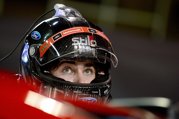 HOMESTEAD, FL - NOVEMBER 20:  Ryan Blaney, driver of the #21 Motorcraft/Quick Lane Tire & Auto Center Ford, stands on the grid during qualifying for the NASCAR Sprint Cup Series Ford EcoBoost 400 at Homestead-Miami Speedway on November 20, 2015 in Homestead, Florida.  (Photo by Jeff Curry/Getty Images)