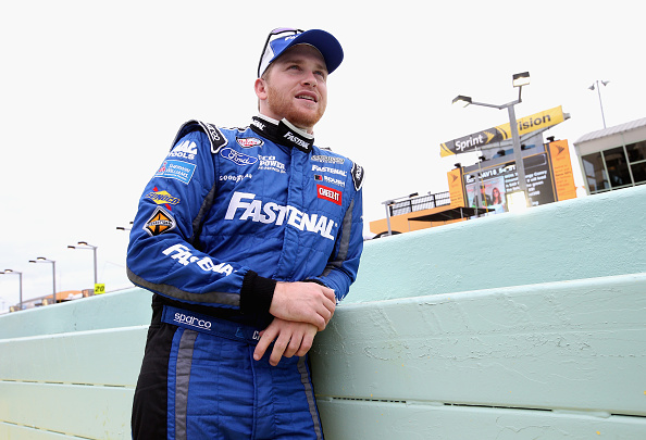 HOMESTEAD, FL - NOVEMBER 21:  Chris Buescher, driver of the #60 Fastenal Ford, stands on the grid during pre-race ceremonies for the NASCAR XFINITY Series Ford EcoBoost 300 at Homestead-Miami Speedway on November 21, 2015 in Homestead, Florida.  (Photo by Sean Gardner/Getty Images)