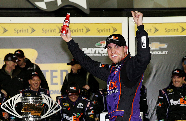 Denny Hamlin celebrates his win in the NASCAR Sprint Cup Series Sprint Unlimited at Daytona International Speedway on February 13, 2016 in Daytona Beach, Florida.