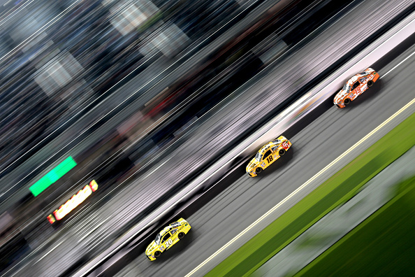 DAYTONA BEACH, FL - FEBRUARY 18: Matt Kenseth, driver of the #20 Dollar General Toyota, leads Kyle Busch, driver of the #18 M&M's 75 Toyota, and Carl Edwards, driver of the #19 ARRIS Toyota, during the NASCAR Sprint Cup Series Can-Am Duels at Daytona International Speedway on February 18, 2016 in Daytona Beach, Florida.  (Photo by Mike Ehrmann/Getty Images)