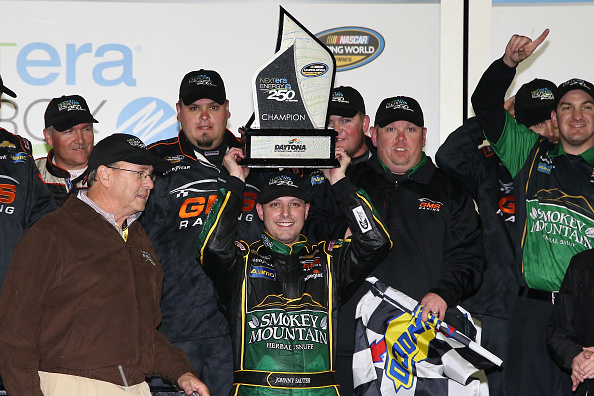 DAYTONA BEACH, FL - FEBRUARY 19:  Johnny Sauter, driver of the #21 Smokey Mountain Herbal Snuff Chevrolet, celebrates in Victory Lane after winning the NASCAR Camping World Truck Series NextEra Energy Resources 250 at Daytona International Speedway on February 19, 2016 in Daytona Beach, Florida.  (Photo by Sean Gardner/Getty Images)