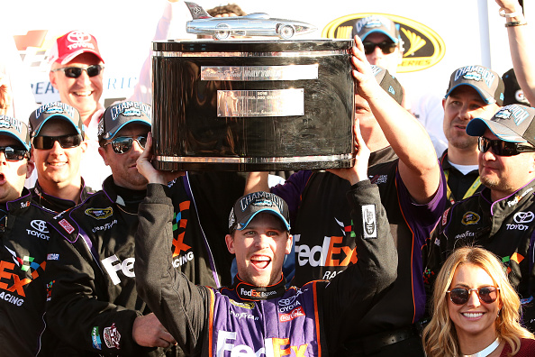Denny Hamlin celebrates after his DAYTONA 500 at Daytona International Speedway on February 21, 2016 in Daytona Beach, Florida.