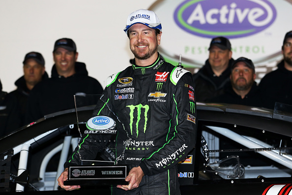 HAMPTON, GA - FEBRUARY 26:  Kurt Busch, driver of the #41 Monster Energy/Haas Automation Chevrolet, poses with the pole award after qualifying for pole position for the NASCAR Sprint Cup Series Folds of Honor QuikTrip 500 at Atlanta Motor Speedway on February 26, 2016 in Hampton, Georgia.  (Photo by Matt Hazlett/Getty Images)