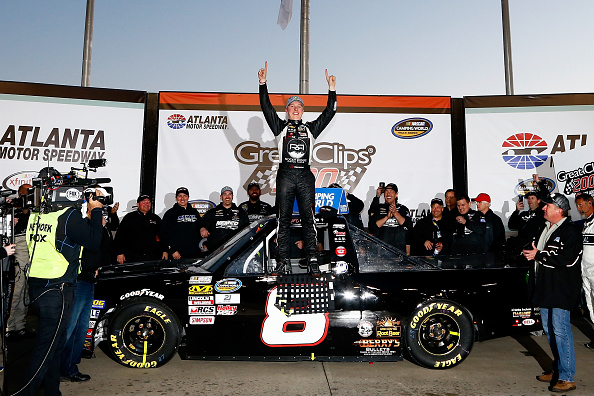 HAMPTON, GA - FEBRUARY 27: John H Nemechek, driver of the #8 farbe technik Chevrolet, celebrates in Victory Lane after winning the NASCAR Camping World Truck Series Great Clips 200 at Atlanta Motor Speedway on February 27, 2016 in Hampton, Georgia. (Photo by Daniel Shirey/Getty Images)
