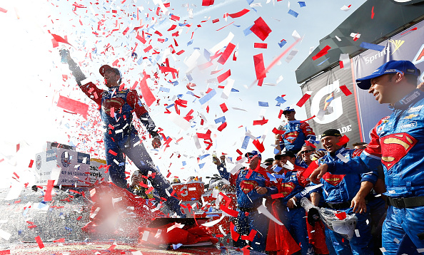 FONTANA, CA - MARCH 20:  Jimmie Johnson, driver of the #48 Lowe's / Superman Chevrolet, celebrates in victory lane after winning the NASCAR Sprint Cup Series Auto Club 400 at Auto Club Speedway on March 20, 2016 in Fontana, California.  (Photo by Jonathan Ferrey/Getty Images)