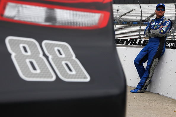 Dale Earnhardt Jr. stands on pit road before qualifying for the NASCAR Sprint Cup Series STP 500 at Martinsville Speedway on April 1, 2016 in Martinsville, Virginia.