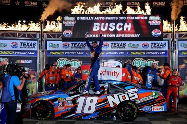 Kyle Busch celebrates after winning the NASCAR XFINITY Series O'Reilly Auto Parts 300 at Texas Motor Speedway on April 8, 2016 in Fort Worth, Texas.