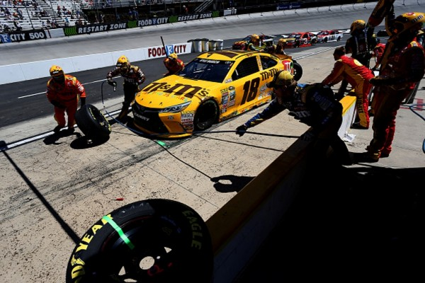 Crew members service the No. 18 Toyota in the pits during the NASCAR Sprint Cup Series Food City 500 at Bristol Motor Speedway on April 17, 2016 in Bristol, Tennessee.