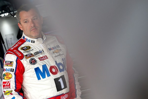 Tony Stewart stands in the garage area prior to practice for the NASCAR Sprint Cup Series TOYOTA OWNERS 400 at Richmond International Raceway on April 22, 2016 in Richmond, Virginia.