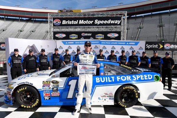 Carl Edwards celebrates his pole at Bristol Motor Speedway Friday with his crew. (Getty Images)