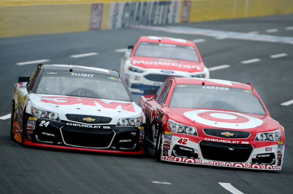 Chase Elliott and Kyle Larson battled to the line Saturday at Charlotte Motor Speedway.