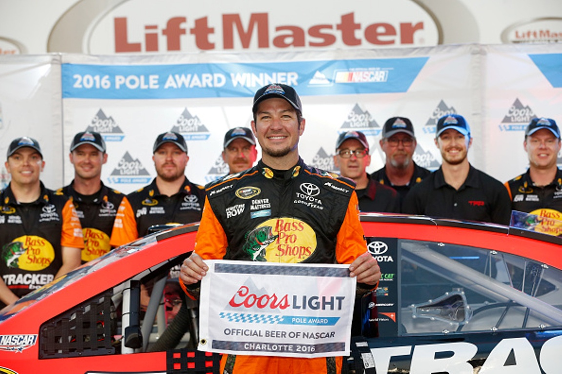 Martin Truex Jr. celebrates after qualifying for the NASCAR Sprint Cup Series Coca-Cola 600 at Charlotte Motor Speedway on May 27, 2016 in Charlotte, North Carolina.
