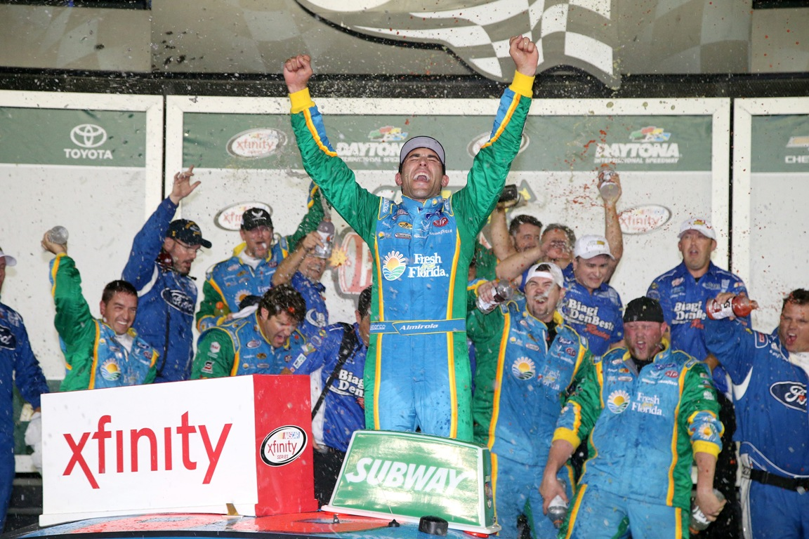 Aric Almirola, driver of the #98 Fresh From Florida Ford, celebrates in Victory Lane after winning the NASCAR XFINITY Series Subway Firecracker 250 at Daytona International Speedway on July 1, 2016 in Daytona Beach, Florida.