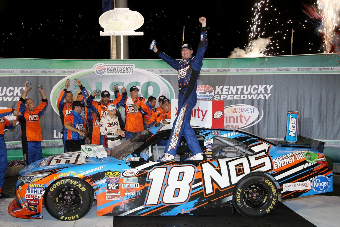 Kyle Busch, driver of the #18 NOS Energy Drink Toyota, celebrates in Victory Lane after winning the NASCAR XFINITY Series ALSCO 300 at Kentucky Speedway on July 8, 2016 in Sparta, Kentucky. (Getty Images)