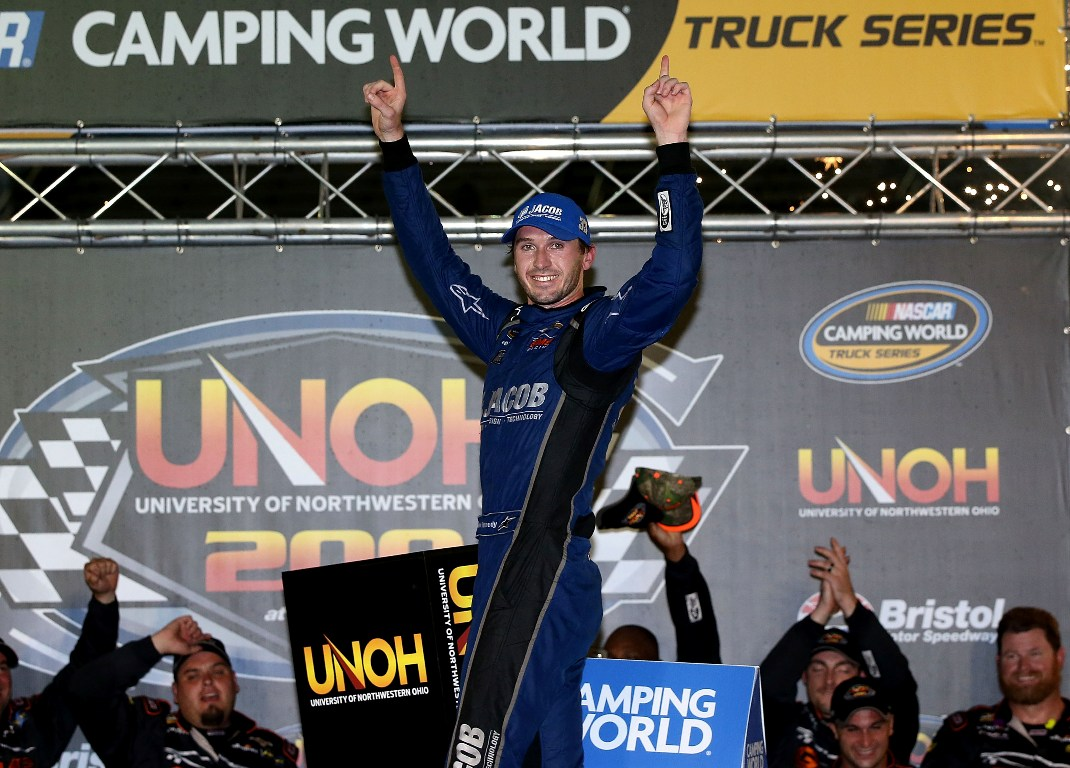 Ben Kennedy, driver of the #33 Jacob Chevrolet, celebrates after winning the NASCAR Camping World Truck Series UNOH 200 at Bristol Motor Speedway on August 17, 2016 in Bristol, Tennessee. (Getty Images)