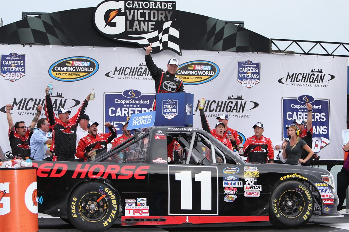 Brett Moffitt, driver of the #11 Red Horse Racing Toyota, celebrates in victory lane after winning the NASCAR Camping World Truck Series Careers for Veterans 200 at Michigan International Speedway on August 27, 2016 in Brooklyn, Michigan. (Getty Images)