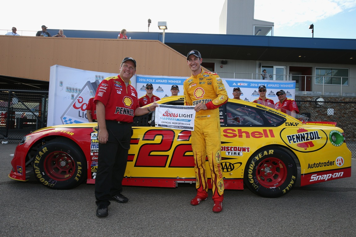 (L-R) Crew chief Todd Gordon and Joey Logano, driver of the #22 Shell Pennzoil Ford, pose with the Coors Light Pole Award after qualifying for the NASCAR Sprint Cup Series Pure Michigan 400 at Michigan International Speedway on August 26, 2016 in Brooklyn, Michigan. (Getty Images)
