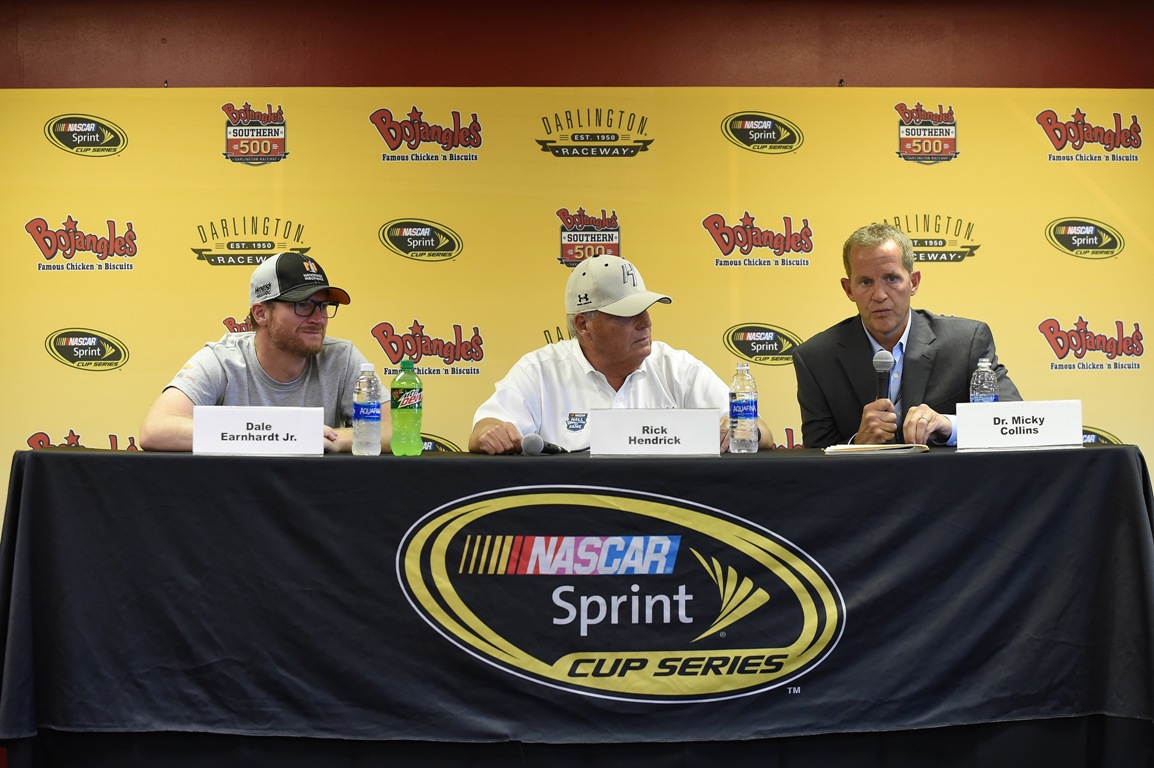 Dr. Micky Collins (R) of the University of Pittsburgh Medical Center Sports Medicine Concussion Program, speaks as Dale Earnhardt Jr. (L) and Rick Hendrick, owner of Hendrick Motorsports, listen during a press conference prior to the NASCAR Sprint Cup Series Bojangles' Southern 500 at Darlington Raceway on September 4, 2016 in Darlington, South Carolina. (Getty Images)