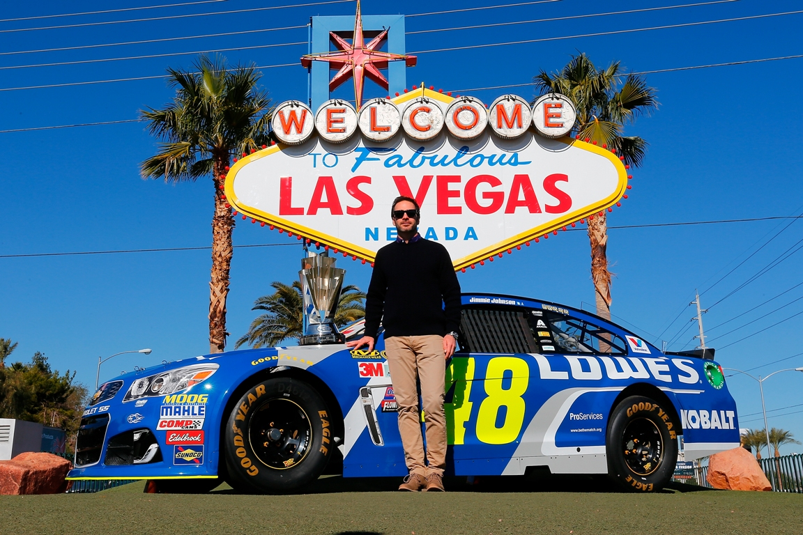 NASCAR Sprint Cup Series champion Jimmie Johnson poses in front of the Welcome to Fabulous Las Vegas sign during NASCAR Champion's Week on November 30, 2016 in Las Vegas, Nevada. (Getty Images)